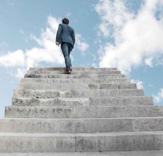 man-climbing-stairs-to-heaven_1154-38