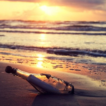 message-in-bottle-beach-sunset-behind-the-sea-187714